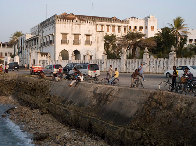 allan tanzania safaris / spot bikers in stone town beachside in zanzibar